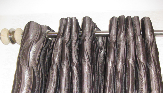 Interlined eyelet curtains close up