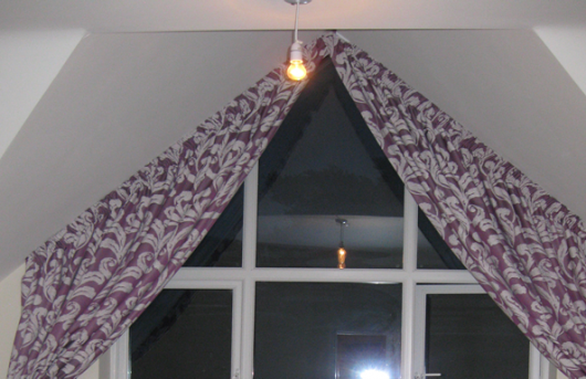 Italian curtains for a gabled window