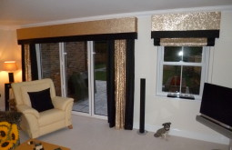 Lounge with glitzy bordered curtains and blind